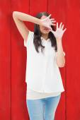 Fearful brunette covering her face — Stock Photo