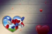 Hearts against green hill — Stock Photo