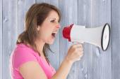 Angry woman with megaphone — Stock Photo