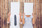Couple holding paper over their faces — Stock Photo