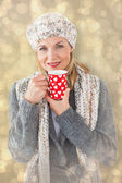 Woman in winter fashion with mug — Stock Photo
