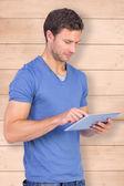 Man scrolling through tablet pc — Stock Photo