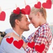 Couple smiling at each other against hearts — Stock Photo #68925019