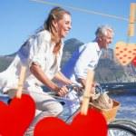 Couple riding their bikes on the beach — Stock Photo #68925173