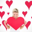Blonde showing red heart — Stock Photo #68925827