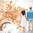 Hipster couple holding hands against world map — Stock Photo #68926121