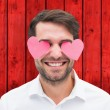 Man with hearts over his eyes — Stock Photo #68926275