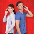 Couple both making phone calls — Stock Photo #68926781