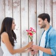 Happy hipster giving his girlfriend roses — Stock Photo #68927235