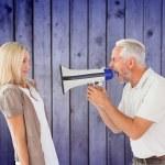 Man shouting at girlfriend through megaphone — Stock Photo #68927261