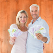 Happy couple flashing their cash — Stock Photo #68927267