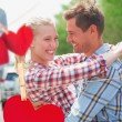 Couple in check shirts and denim hugging each other — Stockfoto #68928903