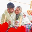 Couple in winter wear with cups — Stock Photo #68929041