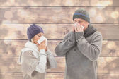 Sick mature couple blowing their noses — Stock Photo