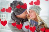 Couple in warm clothing smiling at each other — Stock Photo