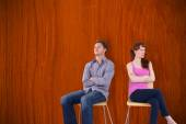 Sitting couple ignoring each other — Stock Photo