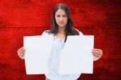 Upset brunette holding torn paper — Stock Photo