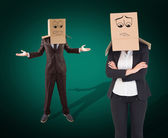 Composite image of businesswoman with box over head — Stock Photo