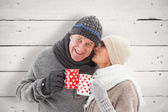 Mature couple in winter clothes holding mugs — Stock Photo