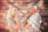 Couple staying silent with fingers on lips — Stock Photo