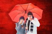 Couple blowing their noses under umbrella — Stock Photo