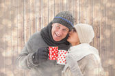 Couple in winter clothes holding mugs — Stock Photo