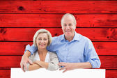 Mature couple smiling at camera — Stock Photo