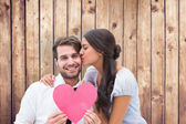 Brunette giving boyfriend a kiss and her heart — Stock Photo