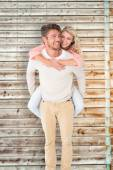 Man giving piggy back to his girlfriend — Stock Photo