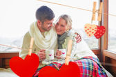 Couple in winter wear with cups — Stock Photo
