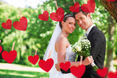 Loving newly wed couple in garden — Stock Photo