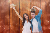 Couple smiling at camera and cheering — Stock Photo