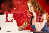 Pretty redhead working on laptop — Stock Photo