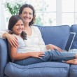 Happy mother and daughter using laptop — Stockfoto #68954265