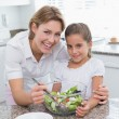 Mother and daughter preparing salad — Stock Photo #68955287