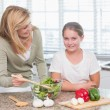Happy mother and daughter preparing salad together  — Stock Photo #68955977