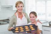 Mother and daughter making cookies together — Stock Photo