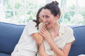 Mother and daughter sharing secrets — Stock Photo