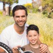 Father and son repairing bike together — Stock Photo #68975763