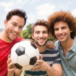 Happy friends in the park with football — Stock Photo #68975883
