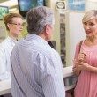 Pharmacist and her customers talking about medication — Stock Photo #68976089