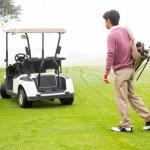 Golfing walking toward the buggy — Stock Photo #68979065