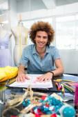 Attractive male fashion designer sketching — Stock Photo