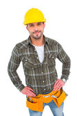 Handyman with hands on hips — Stock Photo