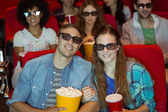 Young friends watching a 3d film — Foto Stock