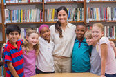 Cute pupils smiling at camera in classroom  — Stockfoto