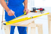 Carpenter working at workbench in office — Stock Photo