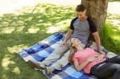 Happy couple relaxing in the park — Stock Photo