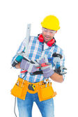 Manual worker balancing various tools — Stock Photo