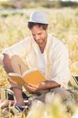 Happy man reading a book — Stock Photo